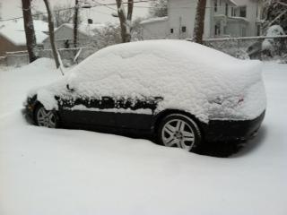 F. Theresa's Jetta, under Boston snow.