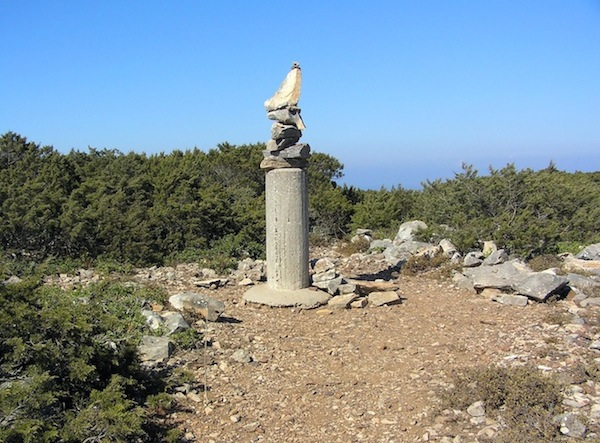 The survey marker atop Mount Papas, made yet higher with the contributions of visitors.