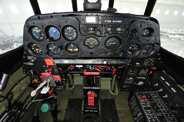 TBM Avenger cockpit. The wing gun arming lever is on the left bulkhead.
