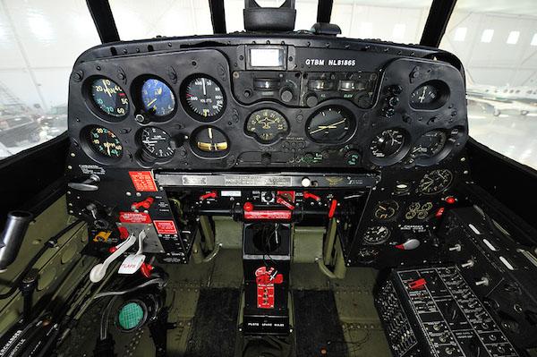 TBM Avenger cockpit. The wing gun arming lever is on the left bulkhead.