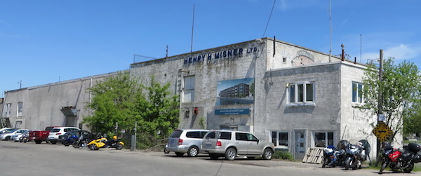 Derelict fish-processing plant, Port Dover Ontario. On the wall, a poster depicting the condominiums that will replace it.