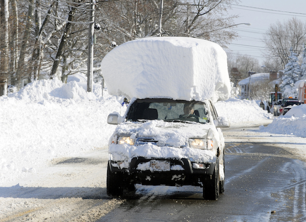 Vehicle with immense snow-mushroom on top.
