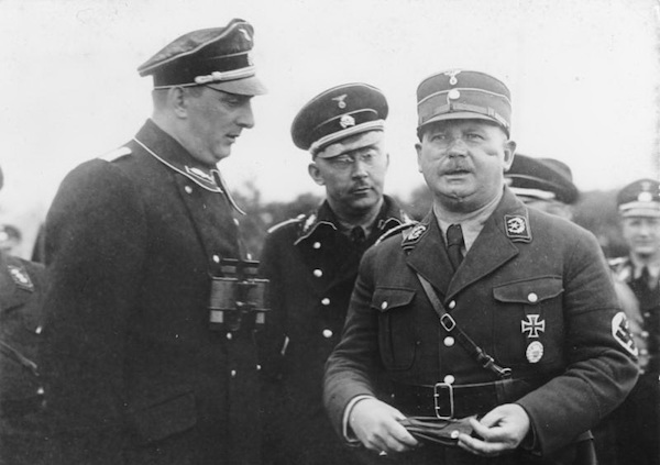 SA Chief Ernst Rohm (right) with SS officials Kurt Daluege and Heinrich Himmler, August 1933.
