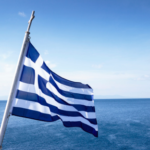 """""""Γαλανόλευκη,"""" or """"Blue-White,"""" flying over the Aegean."""