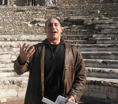 The author, searching for the right words, in Ephesus, Turkey.