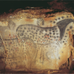 Paleolithic cave paintings of spotted horses with hand prints.