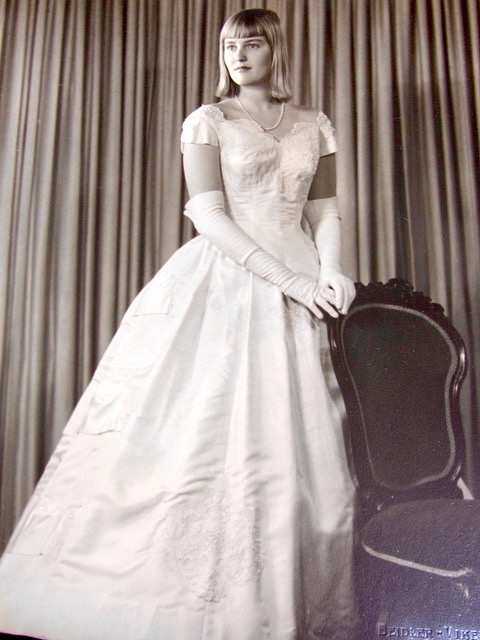 December 1958. My voluminous gown hid the cumbersome spiker cast; not shown, the crutches garlanded with satin ribbons.