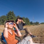 The author and a friend watch the eclipse in a hay field. (Photo: Tim Sullivan)