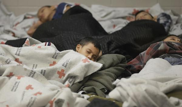 Children sleep in a Texas holding cell. (Photo: Eric Gay/Associated Press)