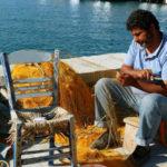 Mending and untangling Greek fishing net.