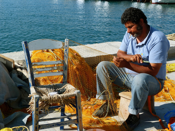Mending and untangling Greek fishing net.