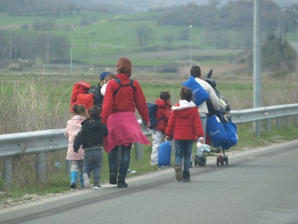 Refugee family walking Hwy A1 toward Idomeni.