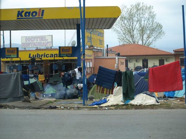 Roadside gas station turned over to refugees walking Hwy A1 toward Idomeni.