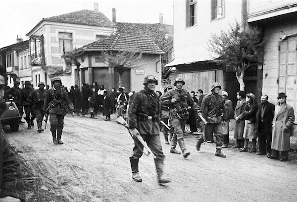 A squad of German soldiers passing through a Greek village, during the Occupation. (Photo by The Associated Press.)