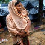 On Bangladesh's border, Rohingya woman and her baby. (Photo: Reuters.)
